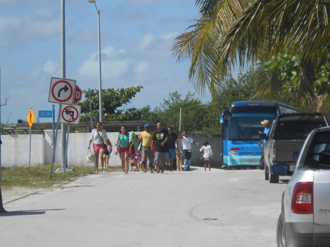 Tour bussess bring a lot of tourists to Mahahual from all around Mexico.