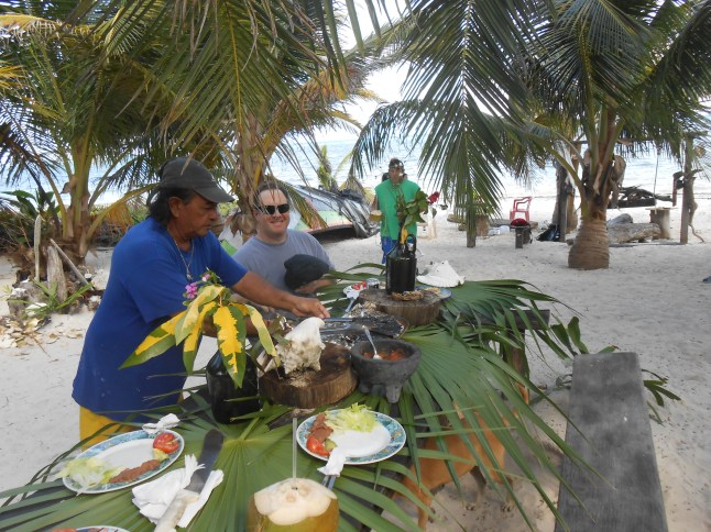 Lunch on Mayan table cloths, palms