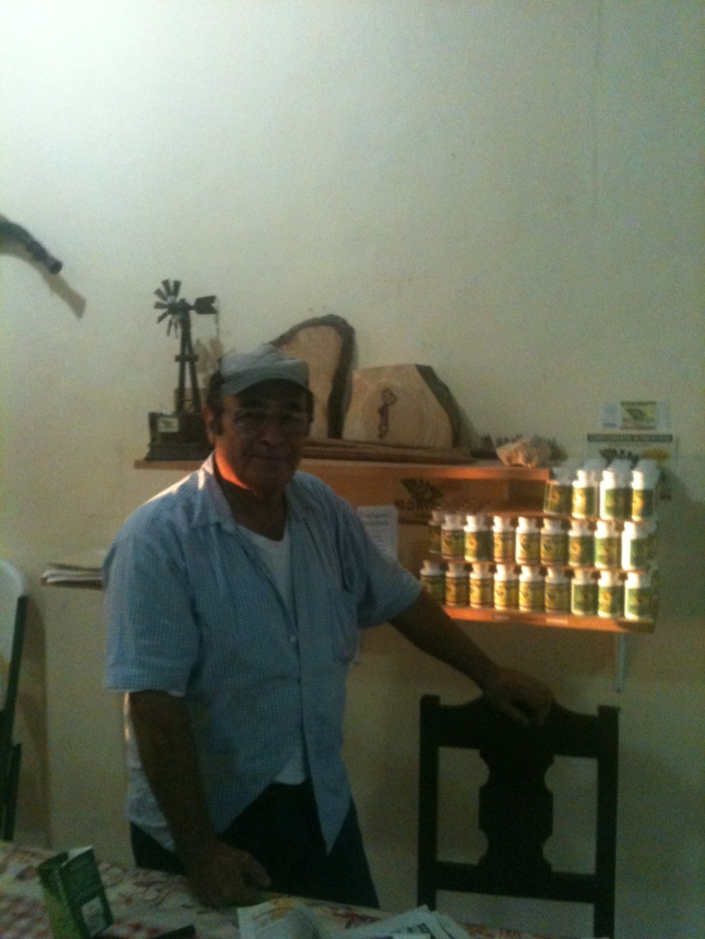 Moroelos in front of his products.