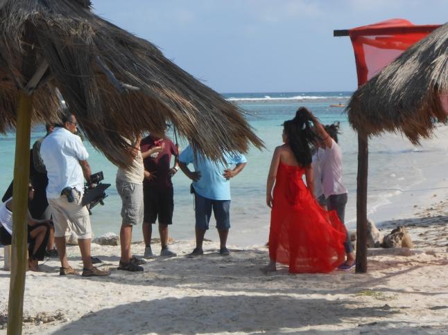 A break in filming on beach.
