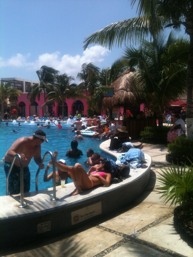 Cruise ship tourists enjoying pool in Costa Maya Port.
