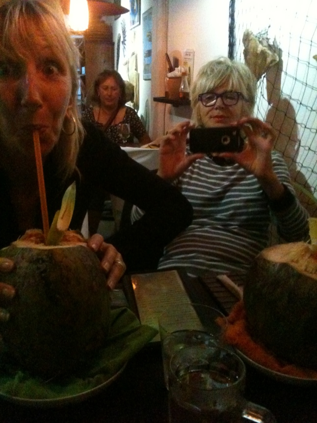 Edith drinking a coco loco.