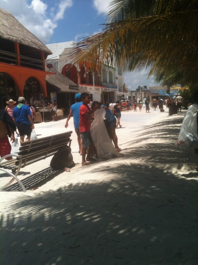 Everybody works in Mahahual on Semana Santa, even little kids who live here collecting all the cans to sell.