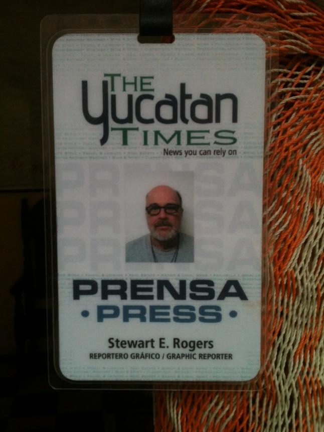 My new press card, I miss my hair.