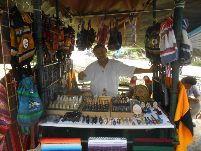 Alex at his booth, he also works at the Costa Maya Port.