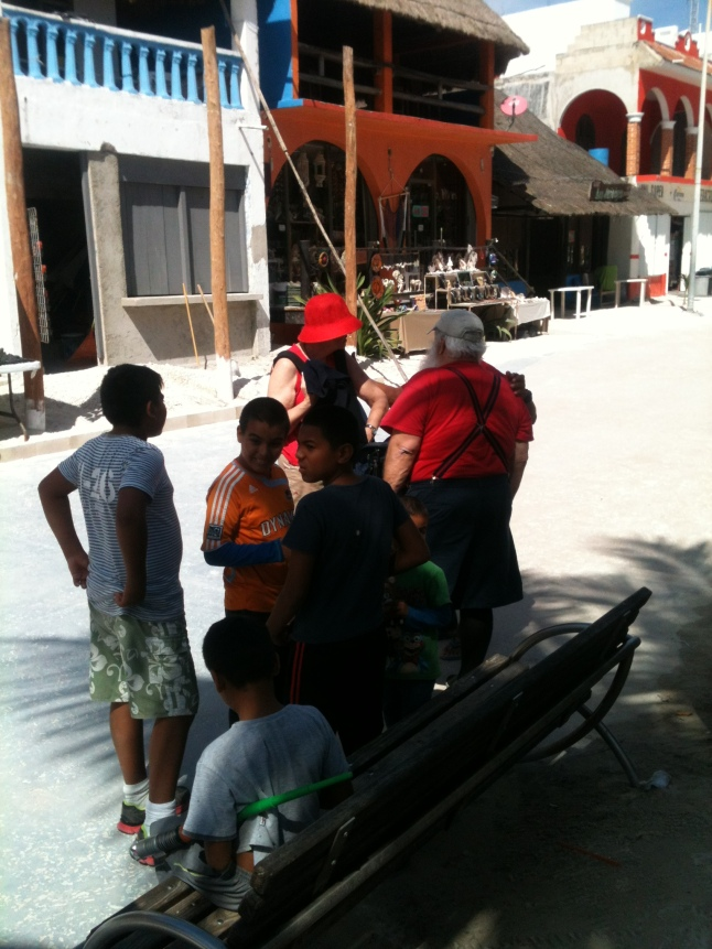 I played a joke on the kids on the malecon the other day.  I told them that this guy was Santa Claus on vacation on a cruise ship in Mahahual.  They believed me, and went up and asked him if he was Santa Claus, he said yes and gave them candy.