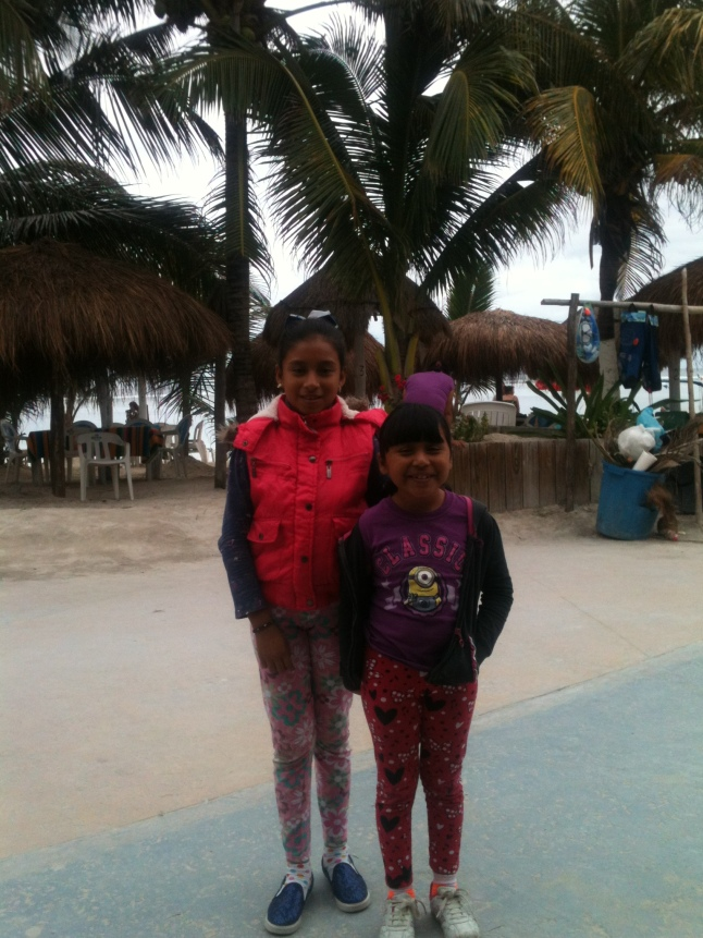 Two local girls on the malecon yesterday dressed for the winter.