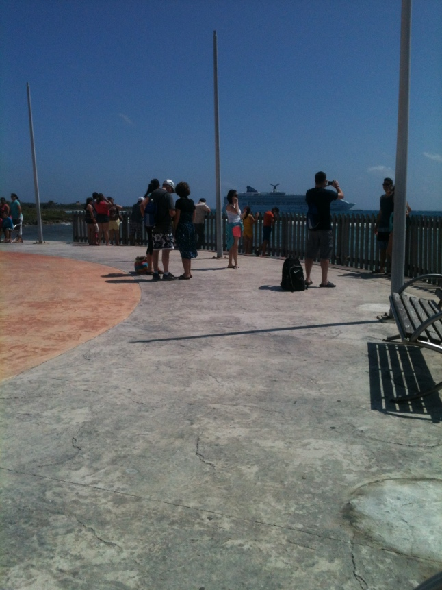 Tourists at lighthouse taking photos.