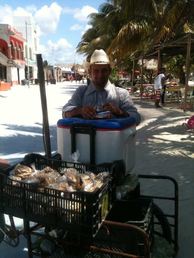 Pedro, the Mennonite, he still works during low season, delivering his fruits and vegatables along the malecon.
