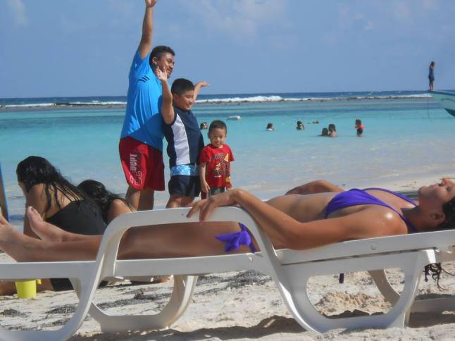 This is one of my favorite photos I have taken in Mahahual. Notice the little Mexican boy checking out the hot woman in a bikini, and his expression. Future ladies man, I bet.