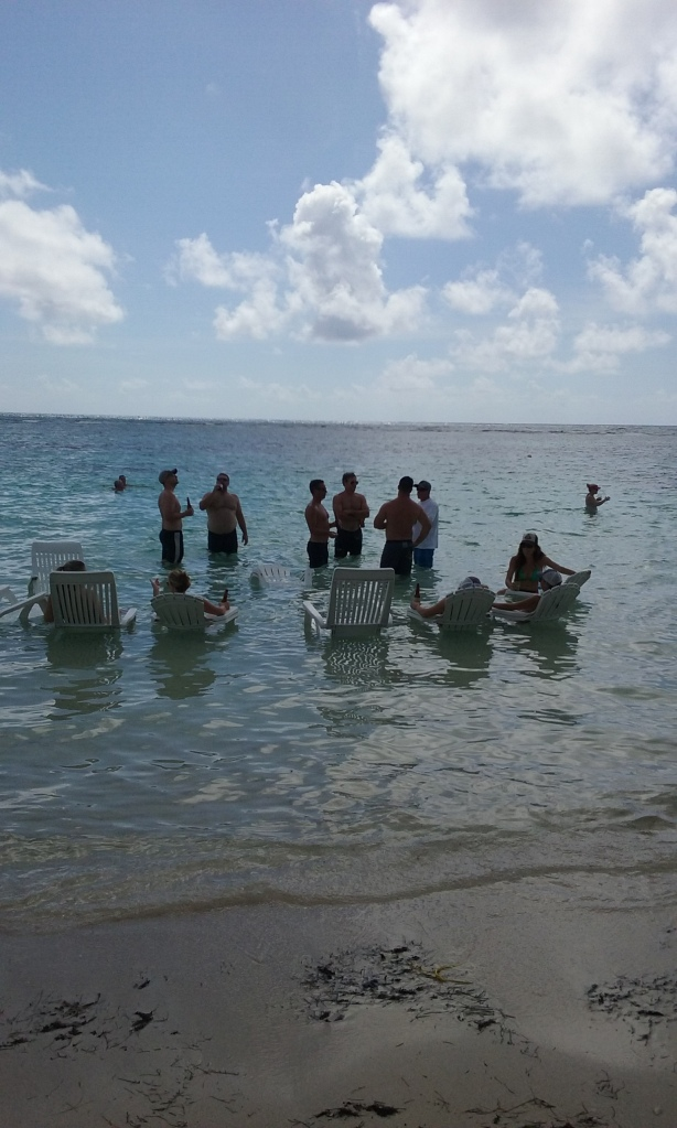 Cruise ship tourists with their chairs in the water, a common sight here.