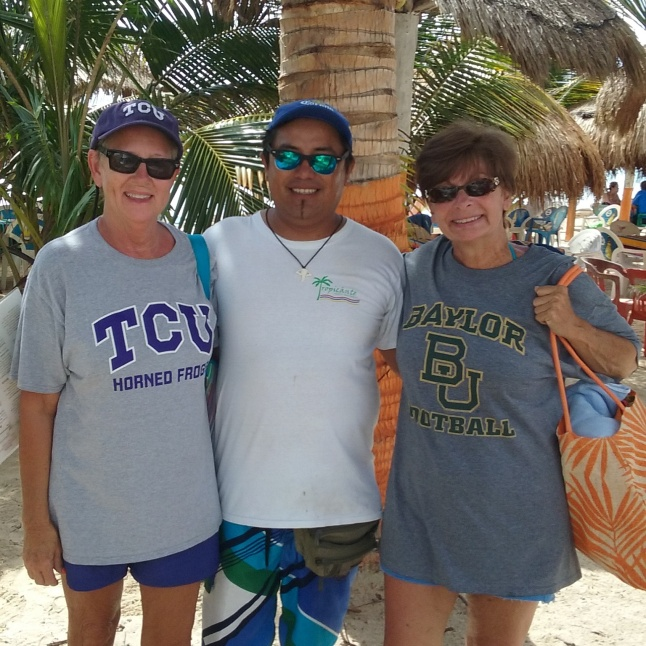 College football time, Kane a waiter at the Tropicante with 2 women from Texas.