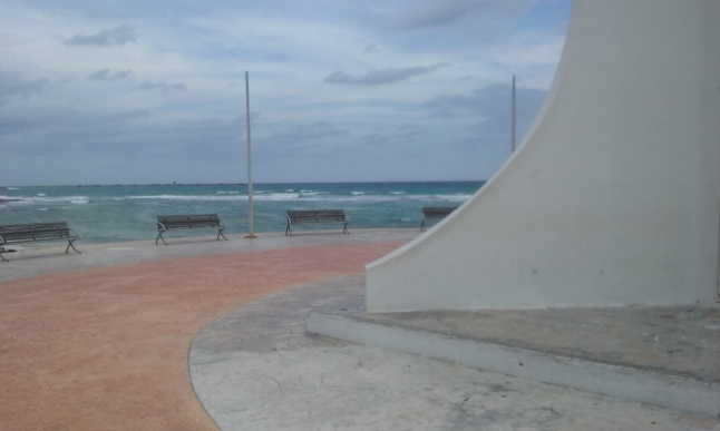 Benches at bottom of lighthouse, great view of the port, and village of Mahahual.