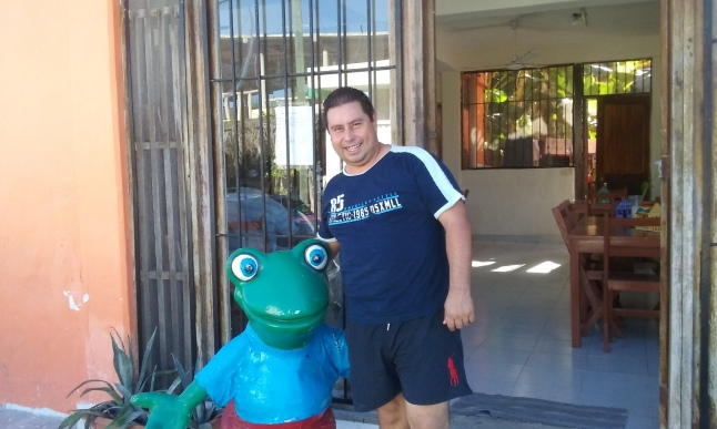 Adrian Urbina Morales with the Senor Frog mascot, he now has in front of his restaurant.  I guess he got it from the port.