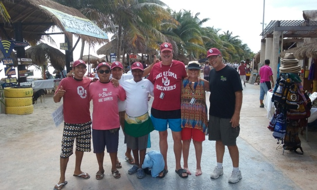 Steve and the wait staff at the Tropicante decked out today in Oklahoma hats and shirts, with some Oklahoma fans off of cruise ship.