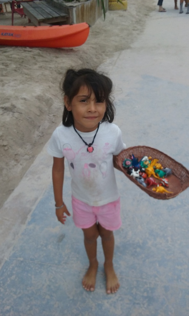 This is my little friend on the malecon, she sells souvenirs to the tourists during the Christmas break from school.  During cruise ship season she works the malecon selling her gifts, she is learning English, and comes by and says hello to me every day  She makes more money than I do, I am sure.
