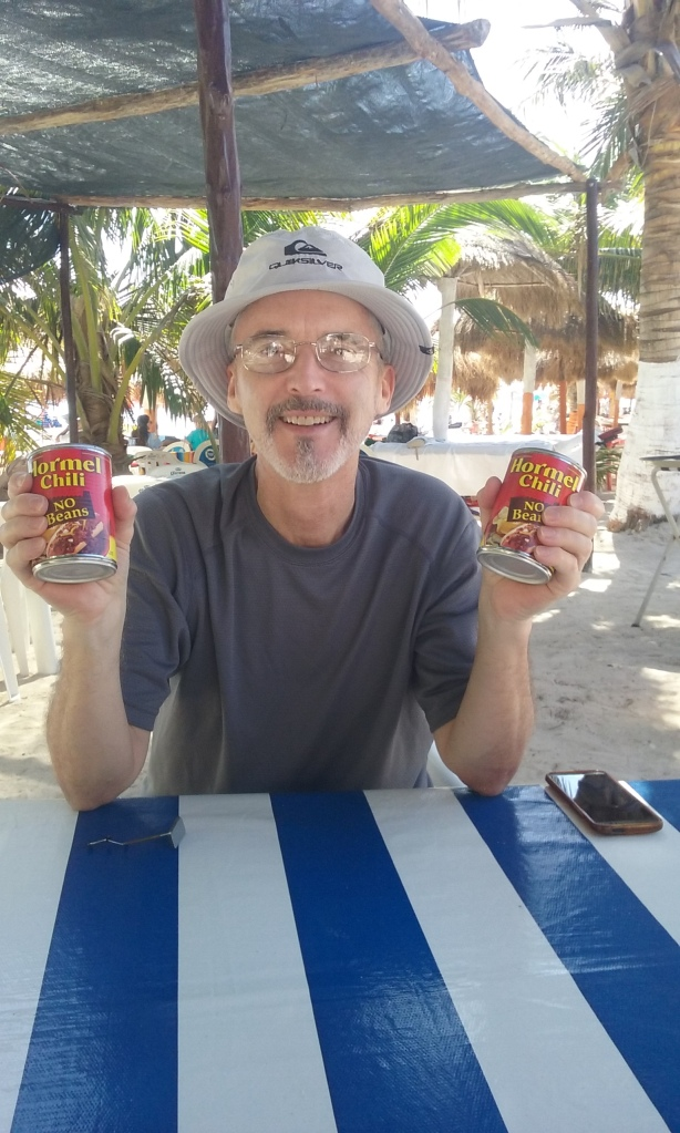 "Chris Reed, aka ""Shed Guy"", on the beach with my Hormel chili, gracias."