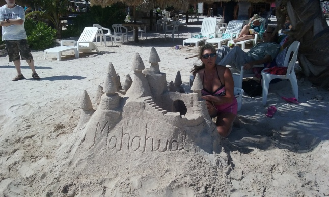 Traci Parsons Hamilton from Dallas, Texas, in process of building a Mahahual sandcastle.